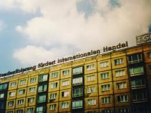 """Standardization supports international trade"": Neon sign atop apartment building on Leipzig's Bayerischer Platz circa 1997 (photo: Jeff Johnson)."